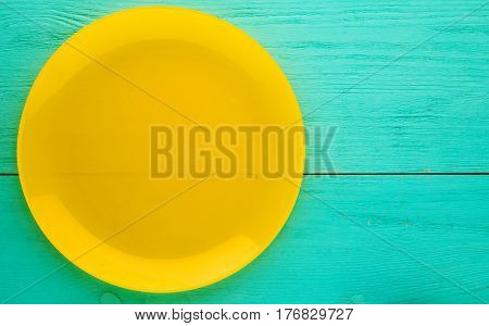 Plate On A Wooden Background.yellow Plate. Plate Top View. Copy Space