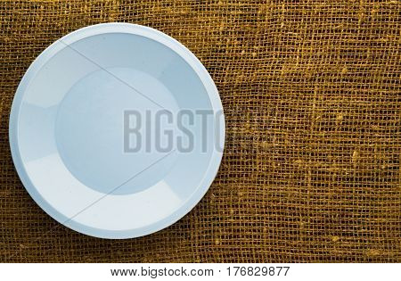 Plate On A Wooden Background.blue Plate. Plate Top View. Copy Space