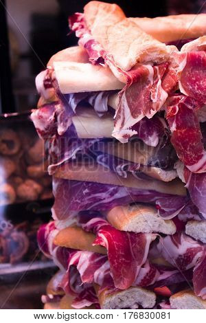 Mountain of Iberian pork ham sandwiches. No people
