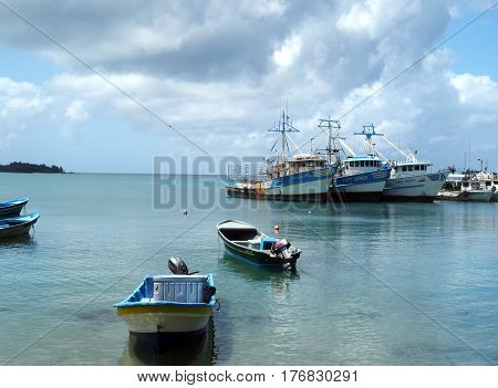 CORN ISLAND NICARAGUA-MARCH 13: Commericial fishing boats and private boats are seen in Caribbean Sea in Brig Bay harbor in Big Corn Island Nicaragua Central America on March 13 2017.