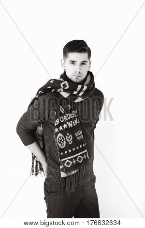 Stylish young brunet in warm scarf