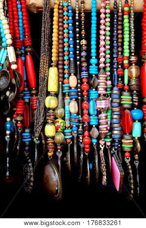 Indian handicrafts of colorful beads against black background