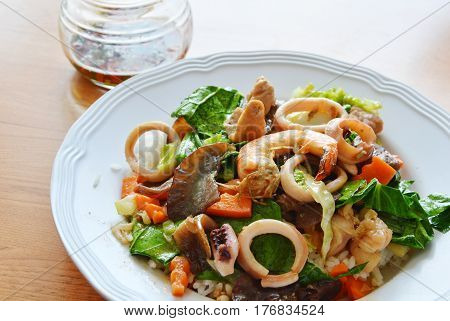 stir fried mixed vegetable with seafood and chili fish sauce