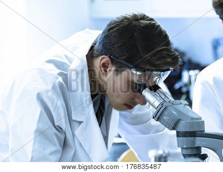 medical research, lab research, laboratory research, chemistry research, young male conduct medical research in the laboratory