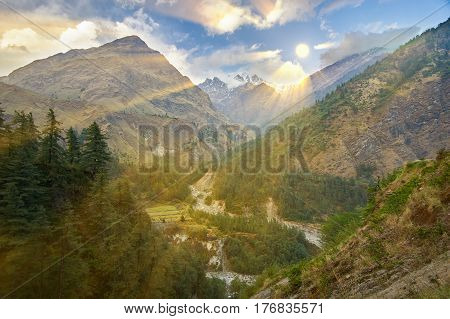The photo was taken during the trek around the Annapurna mountains in the Himalayas of Nepal. A sunny day in the foothills of the Himalayas with dazzling snow-capped peaks in the background. poster