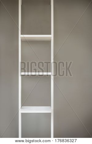 Empty White Narrow Wooden Shelving On Gray Background