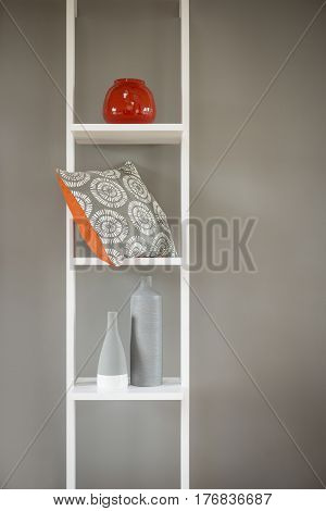 Cushion And Vases In White Wooden Shelving