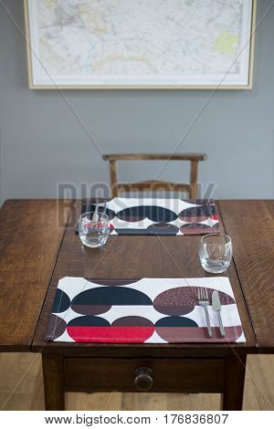 Dinnerware And Drinking Glasses Set On A Wooden Table