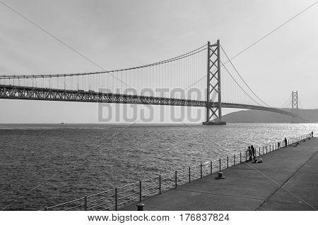 Black and White Akashi Kaikyo Bridge an the longest suspension bridge in Kobe sea port Japan