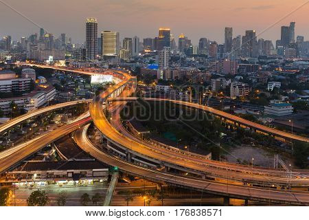 Aerial view Highway interchanged and city downtown background long exposure