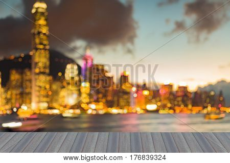 Opening wooden floor Blurred bokeh light night view Hong Kong city downtown abstract background