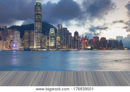 Opening wooden floor Hong Kong business downtown sea front at twilight night view
