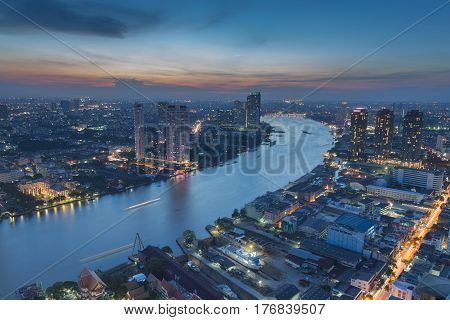 Aerial view Bangkok city downtown and river curved night view Thailand