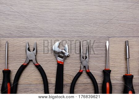 A Set With Tool On A Wooden Table. Hammer, Screwdriver, Gayachnye Wrenches, Pliers, Wire Cutters. To