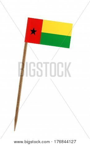 Tooth pick wit a small paper flag of Guinea Bissau