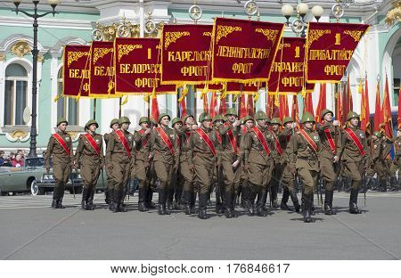 SAINT PETERSBURG, RUSSIA - MAY 05, 2015: A group of soldiers with flags of the great Patriotic war. Rehearsal of parade in honor of Victory Day in St. Petersburg