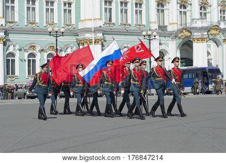 SAINT PETERSBURG, RUSSIA - MAY 05, 2015: A group of soldiers with the banner of Victory and the Russian flag in the solemn March. Rehearsal of parade in honor of Victory Day