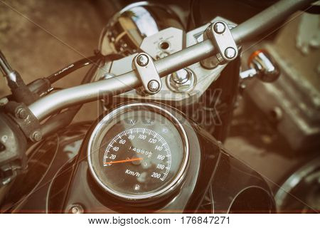 Gauges of old classic motorcycle vintage sepia color effect