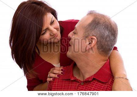 Happy Hispanic couple hugging isolated on white.