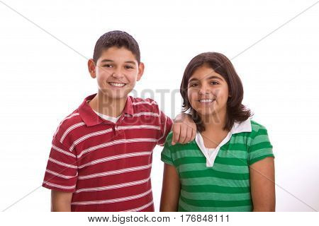 Hispanic brother and sister isolated on white.