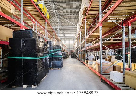Warehouse of Commerce and Industry of transportation. Boxes and crates stocked on the shelves of three storey.