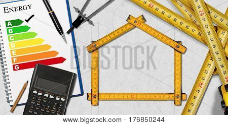 Wooden folding ruler on a desk in the shape of a house with energy efficiency rating and a calculator. Project of ecological house