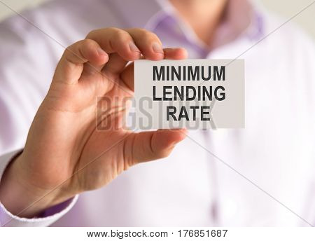 Businessman Holding A Card With Minimum Lending Rate Message