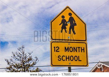 Yellow 12 Month School Sign Warning Motorists
