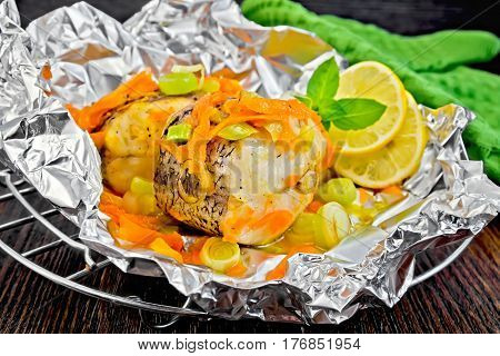 Pike With Carrots And Lemon In Foil On Board