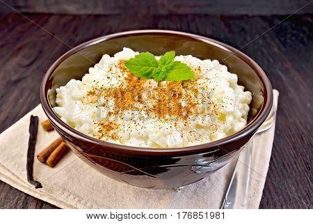 Rice Porridge With Cinnamon In Bowl On Napkin