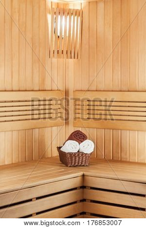 Traditional Wooden Sauna For Relaxation With Basket