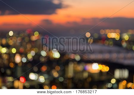Abstract blurred bokeh light Osaka city downtown with sunset sky background