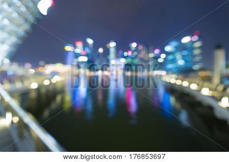 Night blurred light Sigapore city business downtown over the bay abstract background