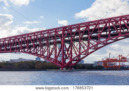Red Minato Bridge over Osaka sea port Japan