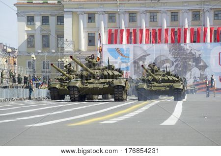 SAINT PETERSBURG, RUSSIA - MAY 05, 2015: T-90 tanks in Palace square. Rehearsal of the Victory parade in St. Petersburg