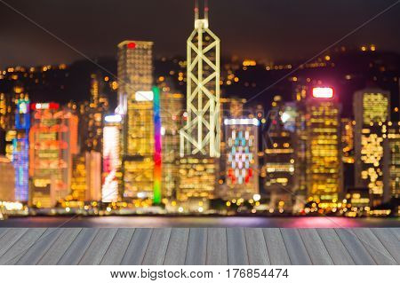 Multiple colour blurred bokeh light night view Hong Kong city downtown opening wooden floor front view