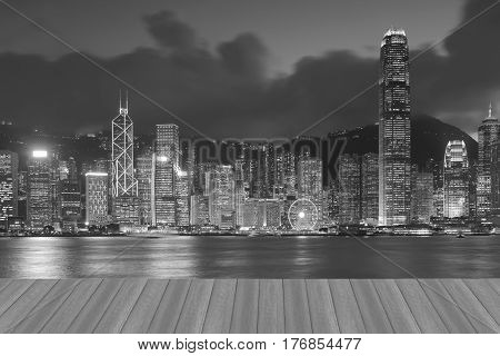 Opening wooden floor central business downtown Hong Kong city over Victoria Bay black and white tone