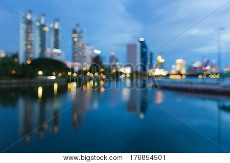Twilight city office building blurred light and reflection abstract background