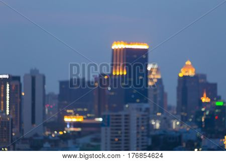 Blurred bokeh city office building business downtown at twilight