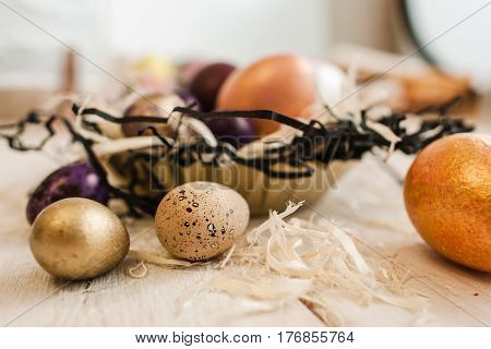 Painted eggs on the white wooden table closeup. Handmade decoration for easter celebration. House decor, tradition, craftsmanship concept