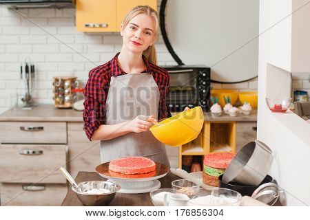 Woman cooking biscuit cake on kitchen background. Gift, birthday celebration , small business, delivery of sweets , culinary craftsmanship, good housewife concept
