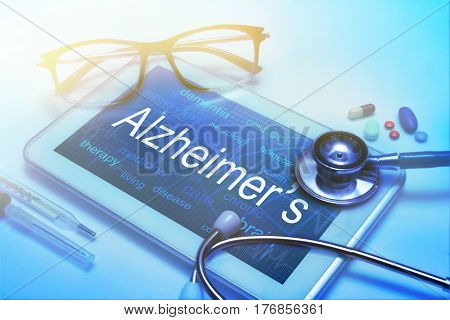 Alzheimer's disease word on tablet screen with medical equipment on background
