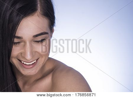 Beautiful Girl. Portrait Of A Smiling Girl On A Blue Background