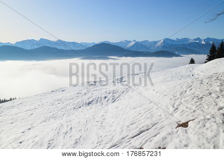 beautiful winter landscape with clouds and ski tracks