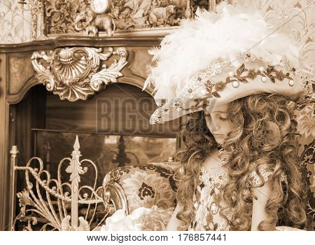 Portrait of sad little girl in carnival costume in style of rococo (Antique stylization, sepia)