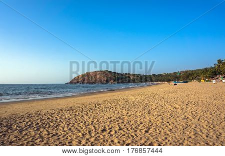 The main town beach of Gokarna India a lot of yellow sand and few people the evening