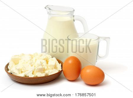 Glass jug pitcher of fresh milk with glass, eggs and cottage cheese isolated on white background carafe