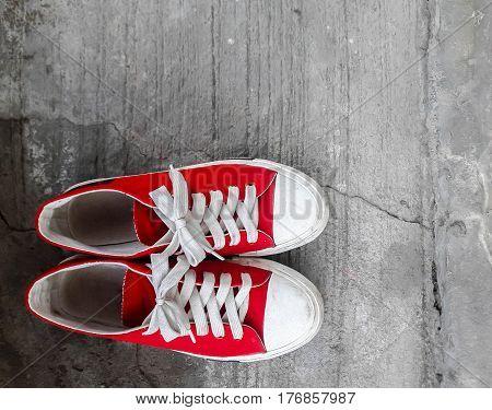 Red sneakers on the floor, top view Portrait concept of young dance floor dance floor