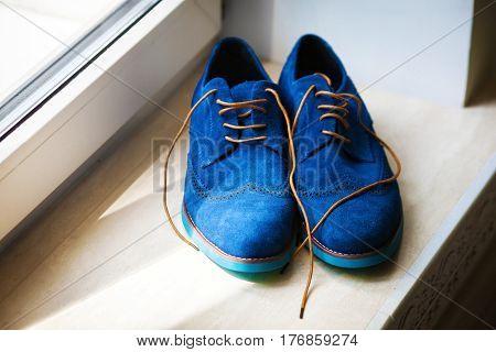Pair of elegant grooms blue suede brogue shoes