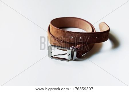 Leather brown belt isolated on white background.